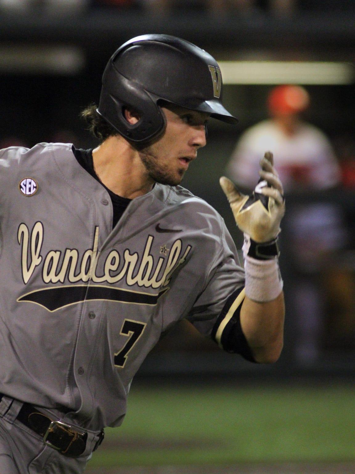 Vanderbilt shortstop Dansby Swanson heads to first