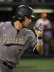 Vanderbilt shortstop Dansby Swanson heads to first base after getting a hit in the NCAA regional baseball game on Saturday, May 30, 2015 in Nashville, Tenn. Many expect Swanson to be the top pick in next week's MLB draft.