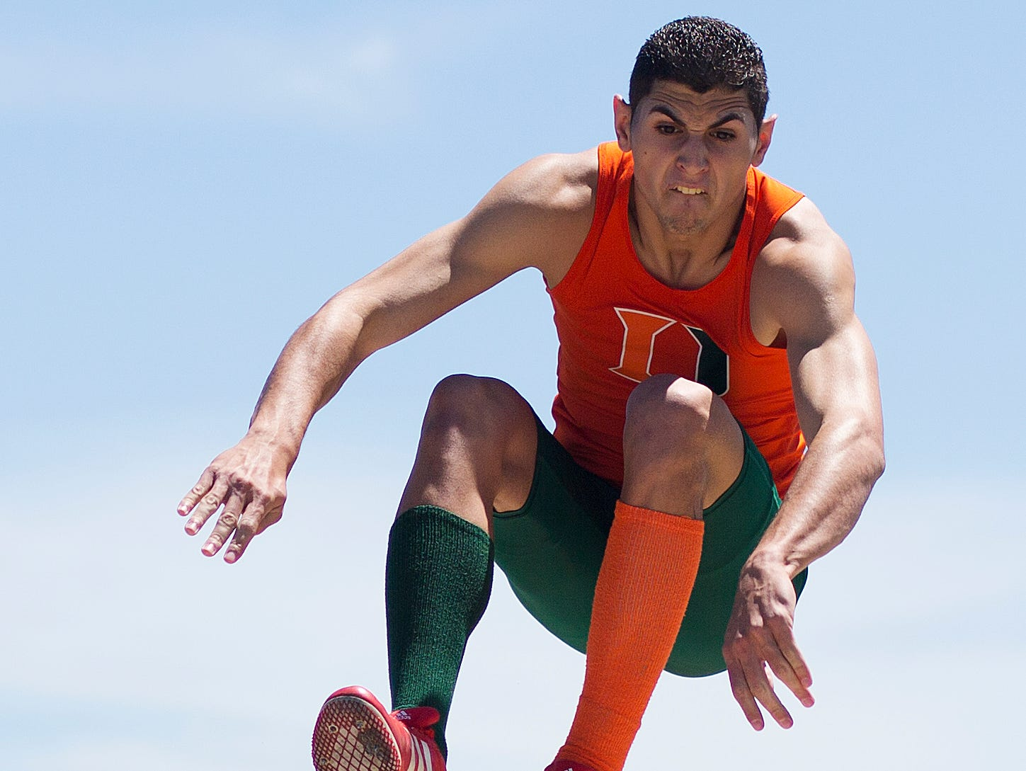 Dunbar High School's Rudy Alverez competes Saturday in the long jump of the LCAC Track and Field Championships at Ida Baker High School in Cape Coral.