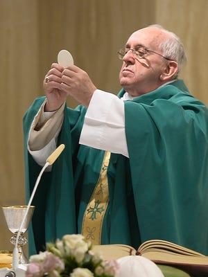 Pope Francis celebrates Mass at the Vatican's Santa Marta hotel on Aug. 31, 2015.