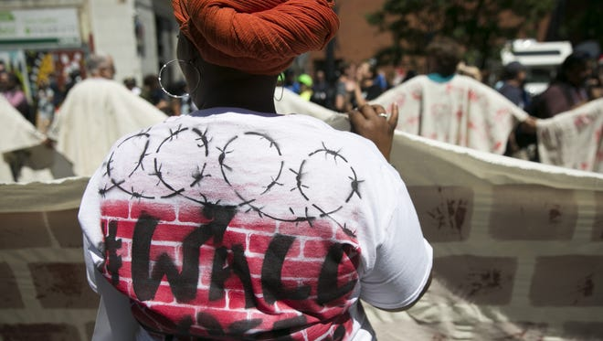 Immigrant-rights activists Mijente, the Ruckus Society, Iraq Veterans Against the War, build a wall protesting outside Republican National Convention in Cleveland, Ohio on Wednesday, July 20, 2016.