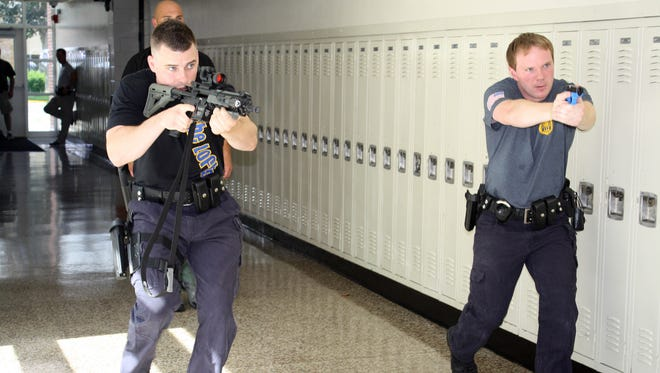Officer John Cambridge and Officer Kevin Condal take part in an active shooter drill at Hasbrouck Heights High School.