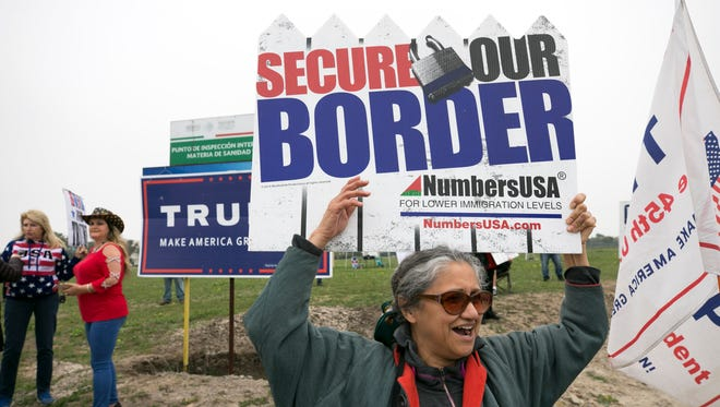 Loree Masonis of Ontario, Calif., cheers during rally in support of President Trump a few miles form where President Trump will visit the border wall prototypes near the Otay Mesa Port of Entry in San Diego, Calif., later in the day on Tuesday, March 13, 2018.