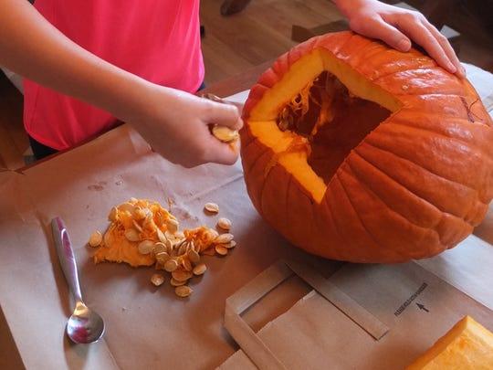 Prepping to roast pumpkin seeds