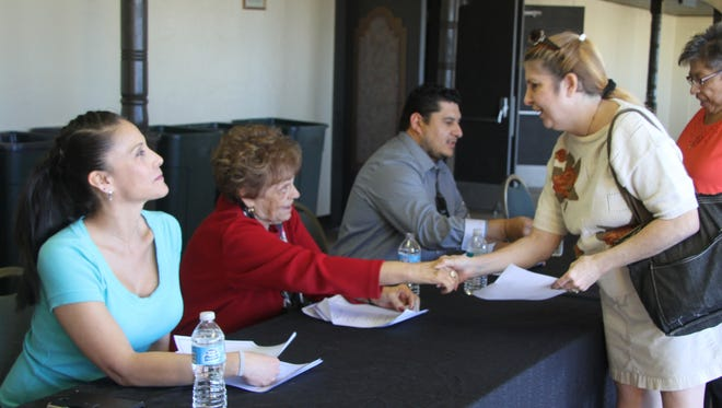 People showed up at the Walter Gerrell's Performing Arts Center in waves to receive a certificate for a free holiday ham from La Tienda on Monday.
