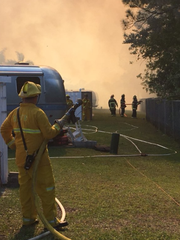 A Brevard County Fire Rescue member helps battle a