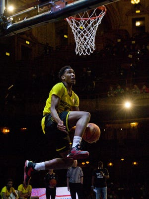 Malik Monk, from Bentonville, Ark., competes in the slam dunk contest during the McDonald's All-American Jam Fest, Monday, March 28, 2016, in Chicago.