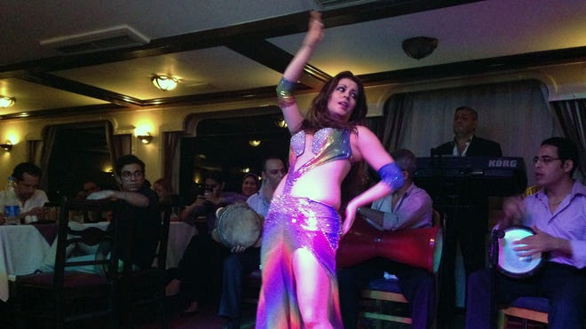 Diana Esposito, an American belly dancer in Cairo known as Luna, performs on a Nile dinner cruise boat on Aug. 12.