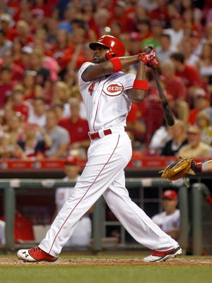 Reds second baseman Brandon Phillips hits a sacrifice fly off Nationals starting pitcher Taylor Jordan in the sixth inning.
