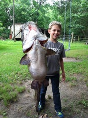 With a little help from his grandfather Buzz Williams, 11-year-old Cooper King caught this 40-pound plus tabby while fishing Black Creek.