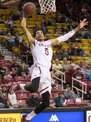 New Mexico State's Matt Taylor goes up for a dunk in a exhibition against Western New Mexico Monday night at the Pan American Center.