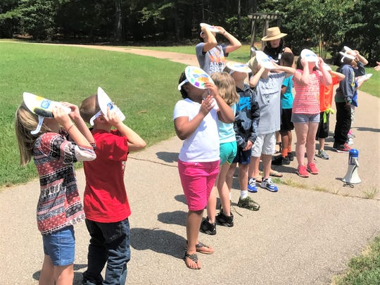 Central Elementary students went out an hour before Totality to try out their Eclipse 2017 glasses.