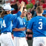 UK's Evan White is congratulated by teammates after scoring the second run in the game in the top of the 3rd inning off UK designated hitter Gunnar McNeill's fly ball. 19 April, 2016
