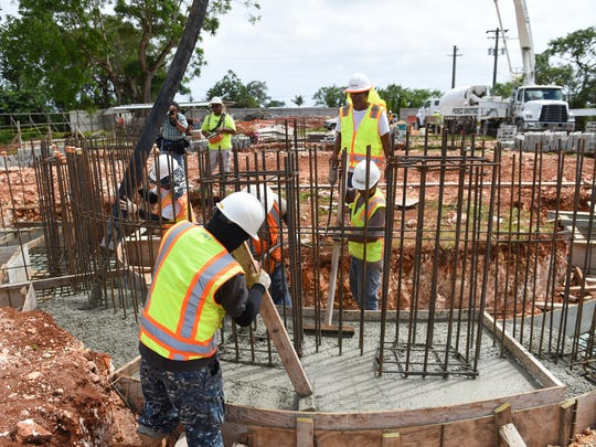 In this March 7, 2017, file photo, construction workers lay a cement foundation for the Divine Mercy — St. John Paul II Chapel in Dededo