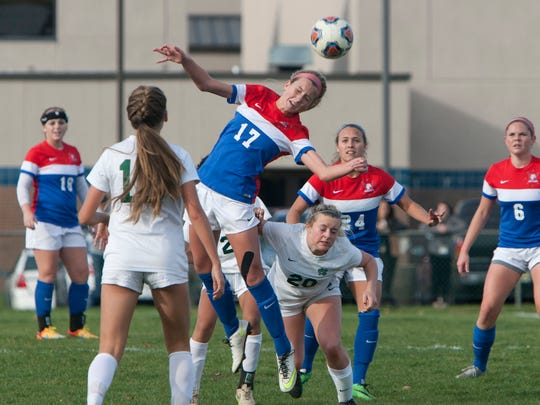 11/9/15 - Wall's Cara Capra heads the ball over Colts