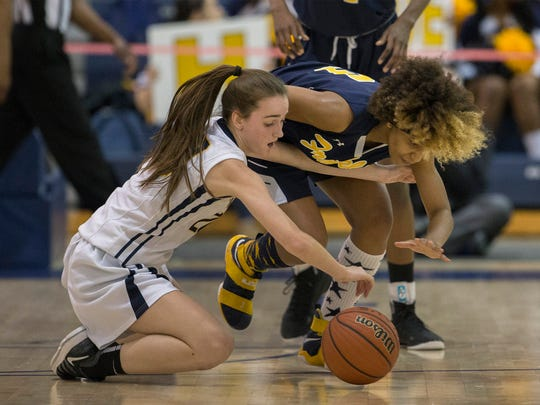 Franklin's Tiana Jackson tries to steal ball away from Toms River North's Amanda Johnson. Franklin Girls Basketball vs Toms River North  in NJSIAA Group IV final in Toms River on March 11, 2018