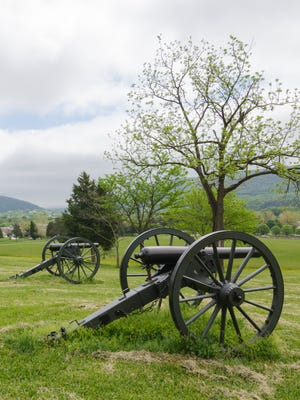 Civil war cannons sit atop a mountain at Harpers Ferry, Virginia. Dennis Frye, recipient of the Ed Bearss Award for Civil War study, is the chief historian at Harpers Ferry.