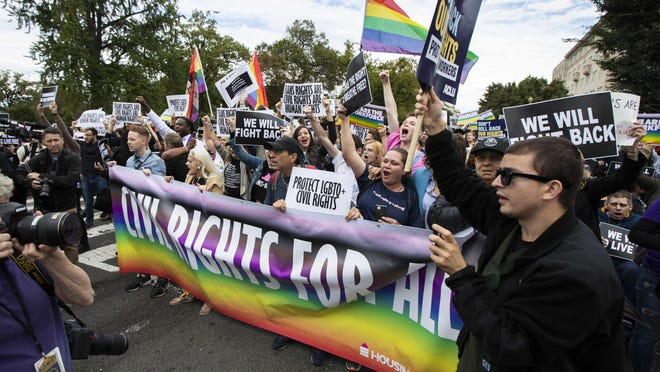 Supporters of LGBTQ rights rally near the U.S. Supreme Court building in Washington in October.
