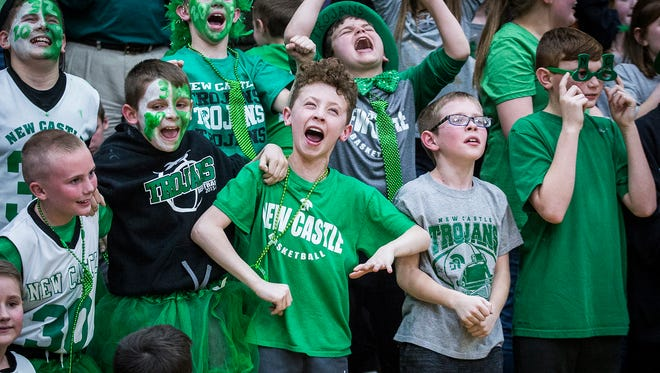 New Castle celebrates defeating Marion in the regional championship game at Marion High School Saturday, March 10, 2018.