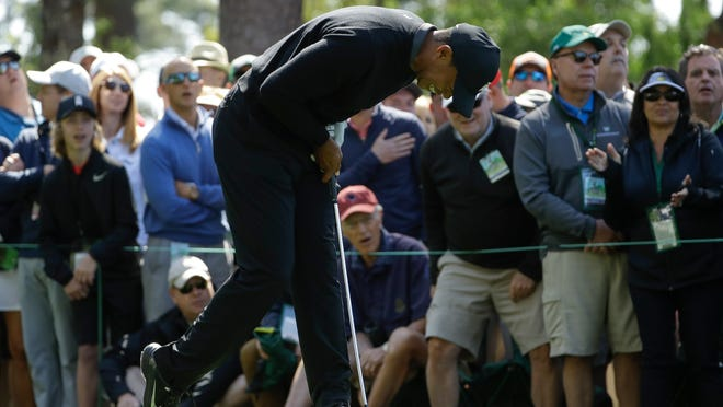 Tiger Woods reacts to a shot on the fourth hole during the first round at the Masters golf tournament Thursday, April 5, 2018, in Augusta, Ga. (AP Photo/Matt Slocum)