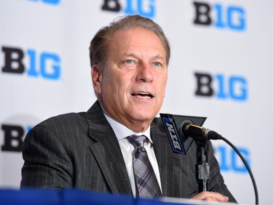 FILE - In this Oct. 13, 2016, file photo, Michigan State head coach Tom Izzo speaks at the Big Ten conference NCAA college basketball media day in Washington. The Big Ten is increasing its conference basketball schedule to 20 games for the men and 18 for the women, starting in the 2018-19 season. The conference announced the change before its men's basketball media day in New York, Thursday, Oct. 19, 2017. (AP Photo/Nick Wass, File)