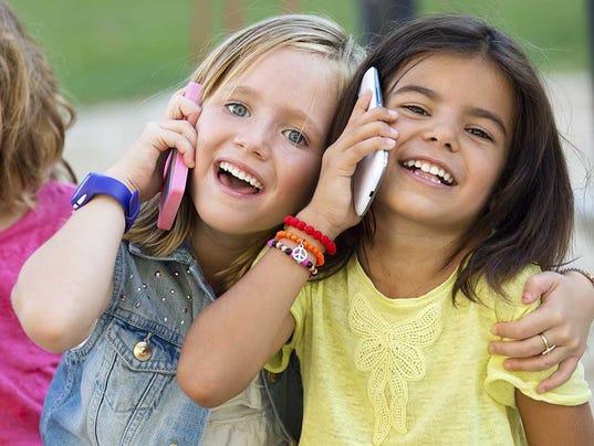 635835480518763976-MC-Nov23-KidsCellPhones-MainCallOut.jpg