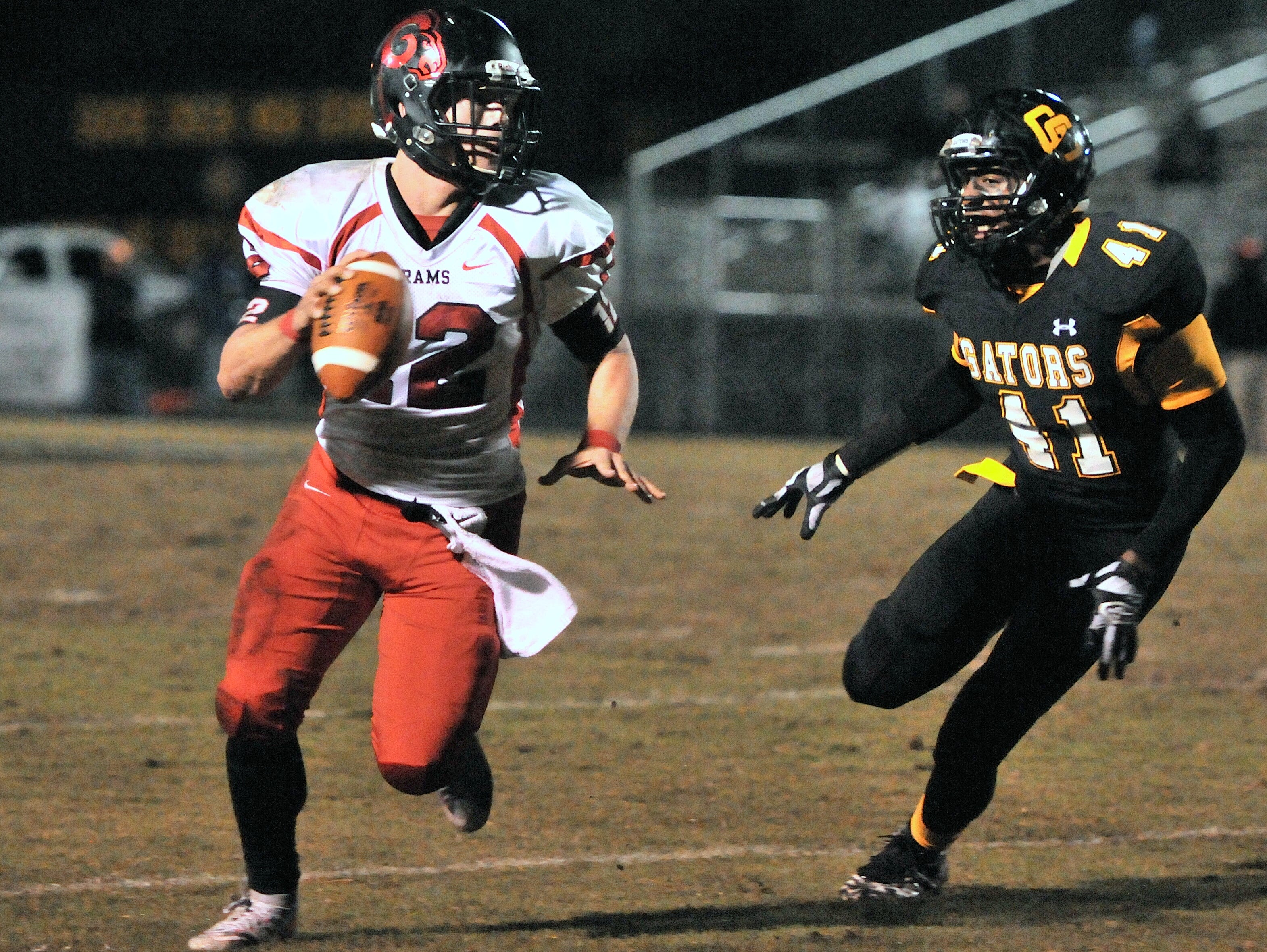 Hillcrest quarterback Colin Sneed looks upfield while being pursued by Goose Creek linebacker Tory Burrell