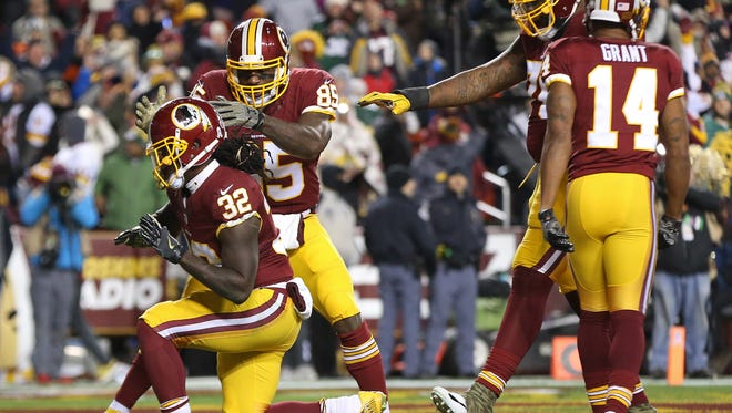 Washington Redskins running back Robert Kelley (32) celebrates after scoring a touchdown against the Green Bay Packers in the second quarter at FedEx Field.
