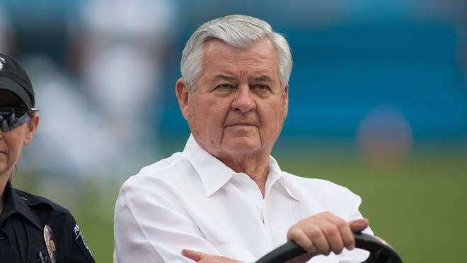 Carolina Panthers owner Jerry Richardson rides on a golf cart prior to the start of the game against the Buffalo Bills at Bank of America Stadium.