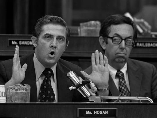 At right listening is Rep. Caldwell Butler, R-Va.  as Rep. Lawrence Hogan, R-Md., left, presents his debate on the impeachment question before the House Judiciary Committee on July 25, 1974 in Washington D.C.