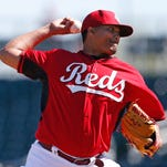 The Reds' Alfredo Simon throws against the Seattle Mariners on March 3.