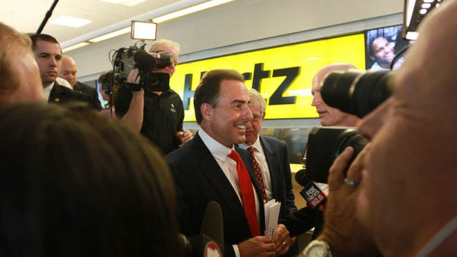 FILE PHOTO: Hertz CEO, Mark Frissora,  along with Florida Governor Rick Scott formally  made the announcement May 7, 2013 at Southwest Florida International Airport that the Hertz Corporation is moving its world headquarters to Estero, Florida.