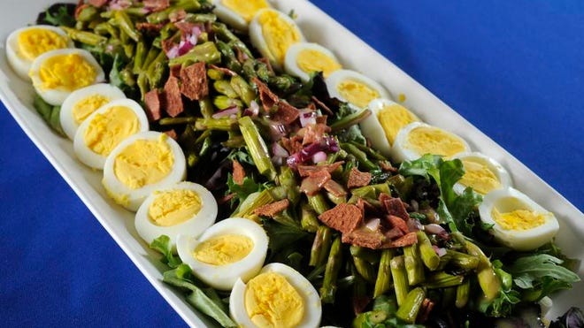 Roasted Asparagus Salad is garnished with hard-cooked eggs.