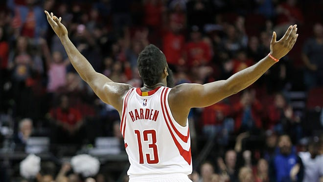James Harden celebrates after making a three-point basket against the Utah Jazz late in the fourth quarter at Toyota Center.