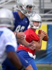 MTSU's quaterback Brent Stockstill looks for a player to pass to during the team's first fall practice, on Thursday, August 6, 2015.