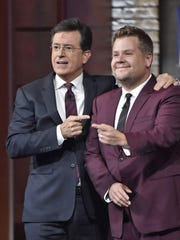 "In this Oct. 9, 2015 photo released by CBS, Stephen Colbert, host of ""The Late Show with Stephen Colbert"", left, appears with James Corden, host of ""The Late Late Show with James Corden."""