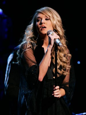 """Carrie Underwood will be singing a new theme song for NBC's """"Sunday Night Football"""" during the first telecast on Sept. 11 between the New England Patriots and the Arizona Cardinals."""