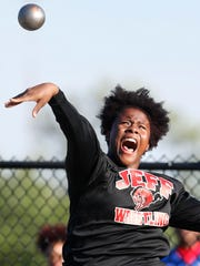 """Essence Henderson with a throw in the girls shot put during the NCC track and field meet Friday, May 5, 2017, at Lafayette Jeff. Henderson won the event with a new NCC meet record of 45' 4 1/4""""."""