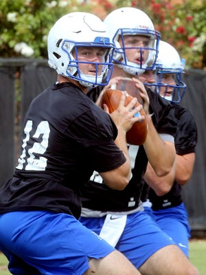 MTSU quarterback Brent Stockstill drops back to pass on the first day of preseason practice July 31, 2017.