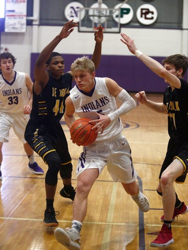Indianola senior Quinn Vesey pushes between Southeast