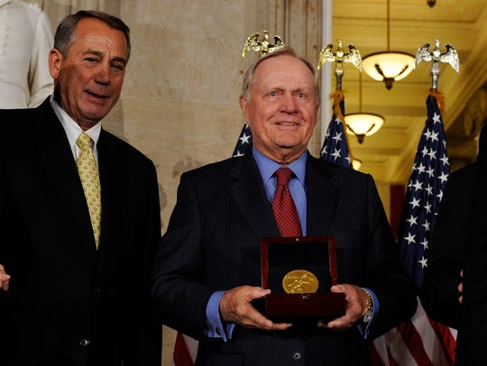 Jack Nicklaus holds his Congressional Gold Medal next