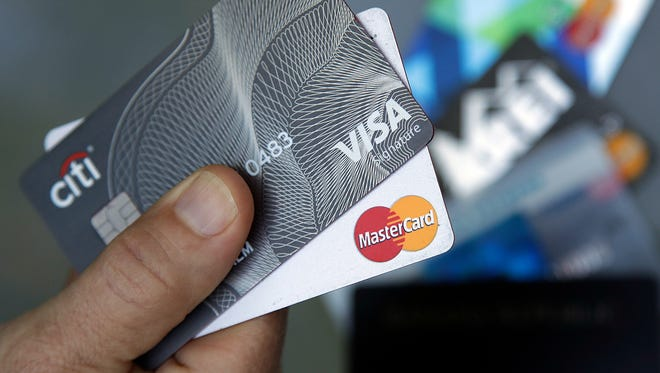 In this June 15, 2017, photo, credit cards are displayed in Haverhill, Mass. Learning that your friend has better credit than you do can be a bummer, but there are ways to improve your credit. (AP Photo/Elise Amendola)