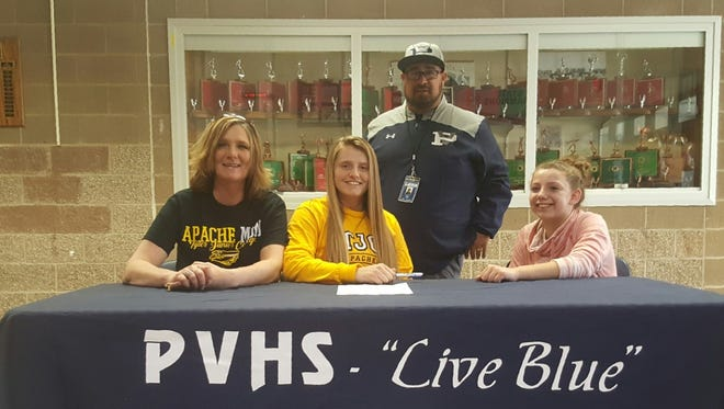 Piedra Vista's Jaden Lance, center, signed a letter of intent to play softball for Tyler Junior College on Wednesday at the Jerry A. Conner Fieldhouse.