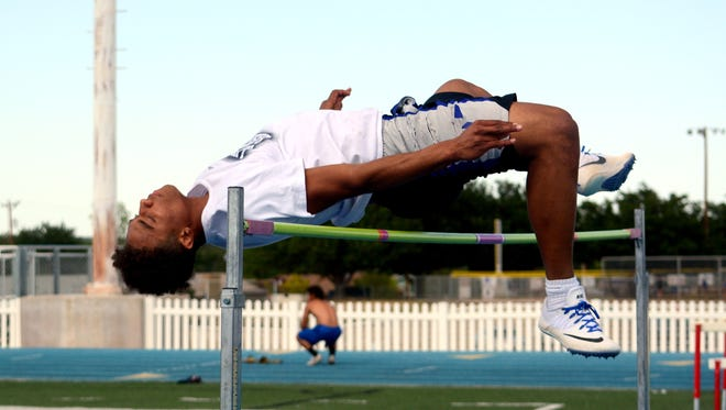 Carlsbad high jumper Chris Johnson wraps up his training at Thursday's practice. Carlsbad will participate in the District 4-6A championships Friday at Hobbs.