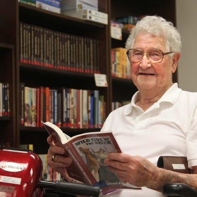 June Thatcher enjoys reading at the Northeast Louisiana War Veterans Home where he is a resident.