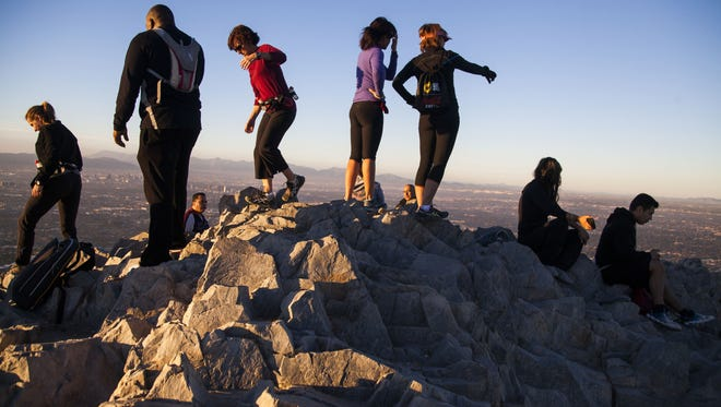 Hikers sit at the top of Piestewa Peak in Phoenix. Phoenix was named the No. 1 city for retirees in a survey by Bankrate.com