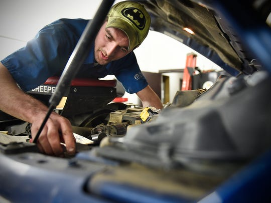 Kyle Bednar  works on a truck Friday, Dec. 18, at Brandl Motors in Little Falls. Bednar suffered a cardiac arrest due to a rare heart condition during his graduation party when he was 17.