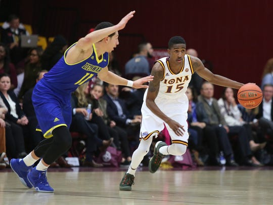 Iona's Deyshonee Much (15) works around Delaware's Devonne Pickard (11)  during a men's basketball game at the Hynes Center at Iona College in New Rochelle on Friday, Nov. 20, 2015.
