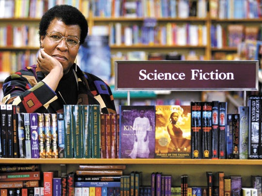 Octavia Butler poses for a photograph near some of her novels at University Book Store in Seattle in 2004.