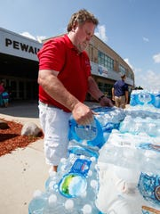 John Watt (JJ's father) helps unload donations for Hurricane Harvey victims at Pewaukee High School on Wednesday, Aug. 30, 2017. The supply drive was organized by the JJ Watt Foundation with help from the Pewaukee School District and a host of volunteers.